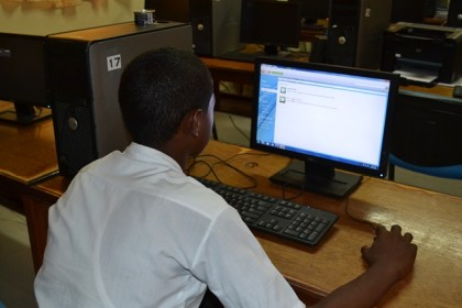 A student of the Johanna Cecilia Secondary School uses a compute in the school's lab which is equipped with eGovernment's 4G LTE Internet service