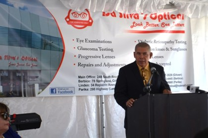 Minister of Public Health, Dr. George Norton giving the feature address at the opening ceremony of the branch of Da Silva's optical, Parika
