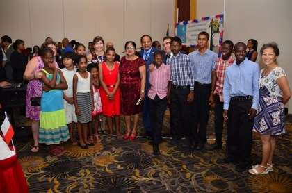 Prime Minister Moses Nagamootoo pose with children who performed at the reception in honour of Chile's 206th Independence anniversary