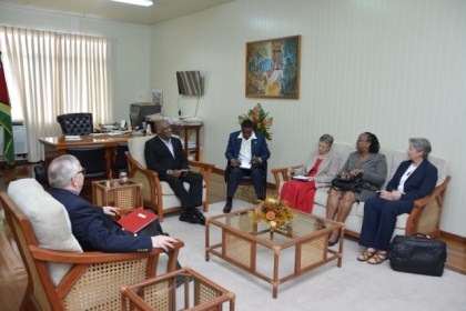 Minister of State, Mr. Joseph Harmon in discussion with the Canadian High Commissioner to Guyana and the Caribbean Leadership Project team.