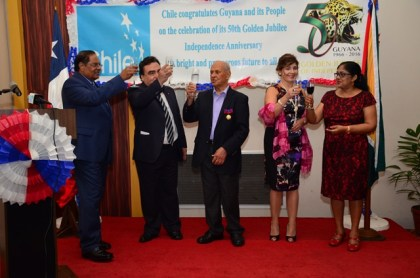 Prime Minister Moses Nagamootoo performing the duties of President, toasts with Chilean Ambassador to Guyana Claudio Rachel Rojas, Honorary Consul to Chile, Yesu Persaud along with the spouse of the Prime Minister, and the Ambassador