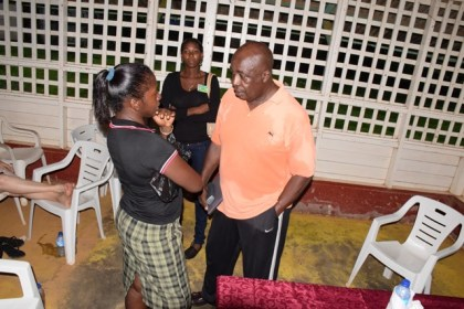 Chairman of the Education Commission of Inquiry, Ed Caesar in discussion with a resident from Port Kaituma, Region One
