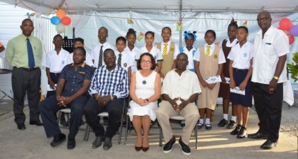 First Lady, Mrs. Sandra Granger (third from left) and Mr. Wesley Benjamin (fourth from left, front row) with the awardees and other village officials.