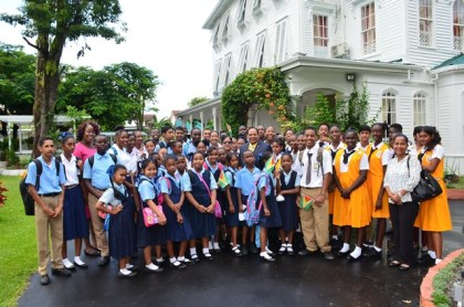Prime Minister Moses Nagamootoo, and his wife Sita Nagamootoo with teachers and students who visited the residence