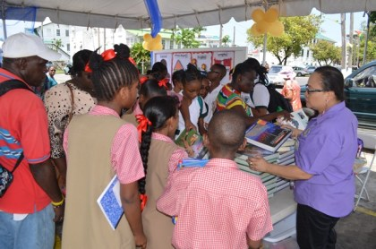 Students browsing the free books that were available at the literacy tent