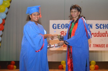 A nurse graduating from the Post Basic Midwifery course