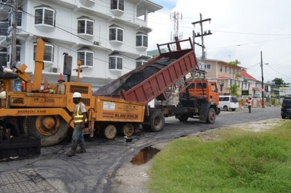 Contractors working on the second half of Waterloo Street, Georgetown