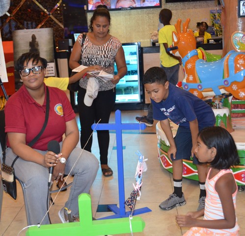 Children interacting with one of the literacy aids at the literacy clinic held at Princess / Ramada Fun City