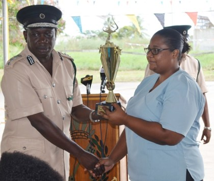 Best Graduating Prison Officer WPO#3469 Rodlyn Jack receiving a trophy at the graduation ceremony held at the Cecil Kilkenny Prison Officers' Training School, Lusignan