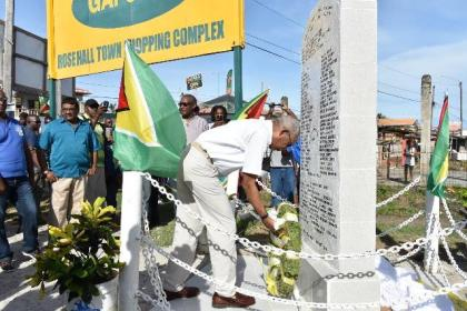 President David Granger laying a wreath at the newly refurbished Rose Hall Town Monument