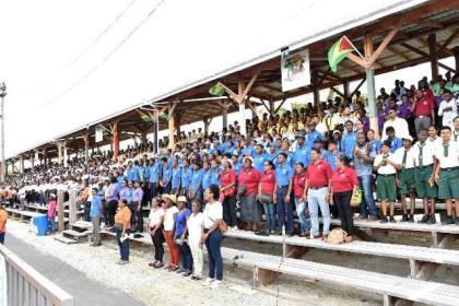 "A section of the crowd at the D'urban Park singing the national song ""Let Us Cooperate for Guyana"""