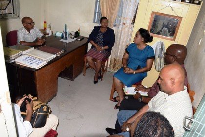 Minister of Social Protection, Volda Lawrence in meeting with HM Chandradeo Mahadeo and Senior Teacher Candacie McGregor in the presence of Mayor Ganesh Gangadin