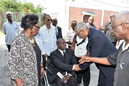 President David Granger expressing his condolences to Mr. Kenwyn Carmichael, the son of the late Mr. Fitz Carmichael at the St. James The-Less Anglican Church