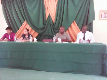 Seated from right to left; Chairman of the closing ceremony, youth participant, Mr. Wayne Wilson, Ms. Adeti de Jesus, Senior Research and Planning Officer, PAYEU, Mr. Aubrey C. Norton, Presidential Advisor on Youth Empowerment, Mr. Ronald Austin, Senior Education and Training Officer, PAYEU.