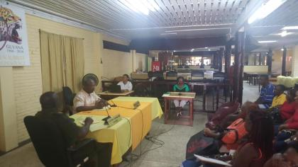An ex-GNS member  testifies before the  Veteran Commission Inquiry at the GNS Club at Carifesta Avenue