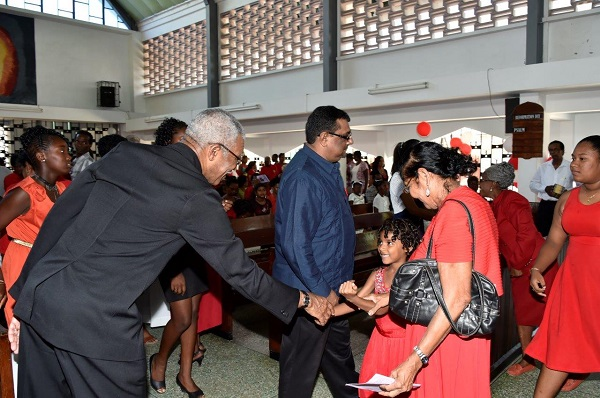 President David Granger greets a young worshipper at the Ebenezer Lutheran Church this morning, during the quincentenary observances