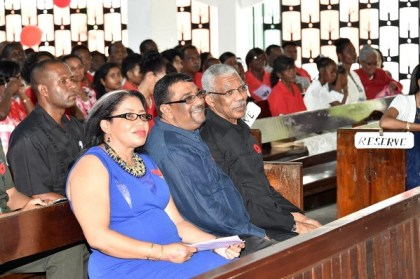 President David Granger, Regional Chairman, Mr. David Armogan and Regional Executive Officer, Mrs. Kim Stephens share a light moment during the Ebenezer Lutheran Church service earlier today, in New Amsterdam