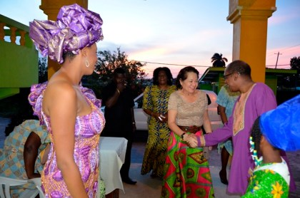 Mr. Eric Phillips welcomes First Lady, Mrs. Sandra Granger to the Sikukuu ya-Mwaka, earlier this evening at the Akwaaba Centre, Thomas Lands as Mistress of Ceremonies, Ms Shabakie Fernandes (first left) and Ms. Trovina Ellis (first, right) look on.