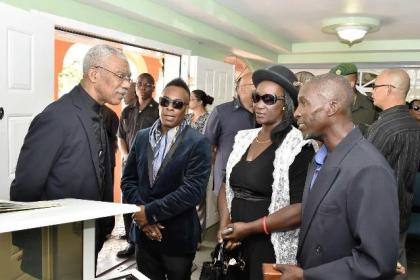 President David Granger expressing his condolences to the children of the late Mr. Malcolm Corrica aka Lord Canary