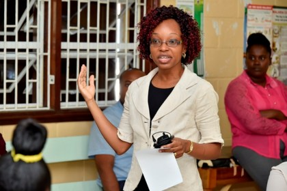Dr. Krystle Fraser makes her presentation at the launch of the Teenage Pregnancy Support Group at the Sophia Health Centre yesterday.