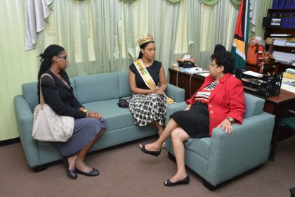 Minister of Social Cohesion, Ms. Amna Ally and Miss World Guyana 2016, Ms. Nuriyyih Gerrard, during a courtesy call at the Ministry of Social Cohesion. Miss World Guyana Operations Manager, Ms. Malika London is pictured at left.