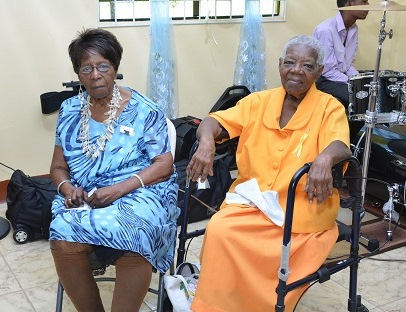 Two of the oldest surviving members of the SANRIC Senior Citizens Group, (L-R) Past President of the group, Sister Joyce Butts and Sister Dorris Williams