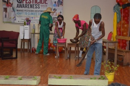 Students dramatizing the improper handling and effects of pesticides and toxic chemicals on human health and the environment at the PTCCB drama competition finals at the Ramada Princess