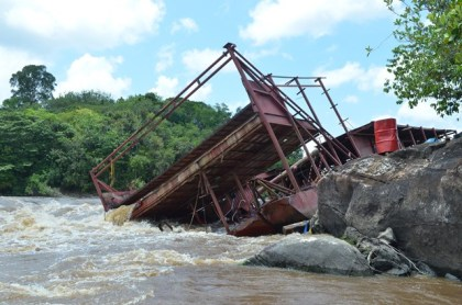 The damaged and listing Crown Mining dragga in the Mazaruni River