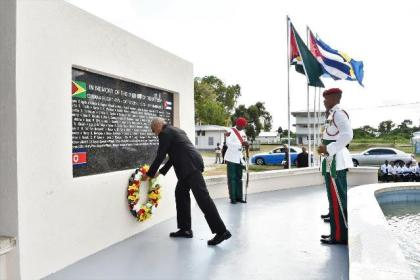 President David Granger lays a wreath at the foot of the Cubana Air Disaster Monument, located on the University of Guyana's Turkeyen Campus, to commemorate the 40th anniversary of the attack.