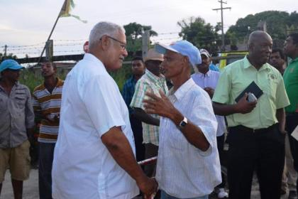 Minister Holder engaging a farmer after the meeting