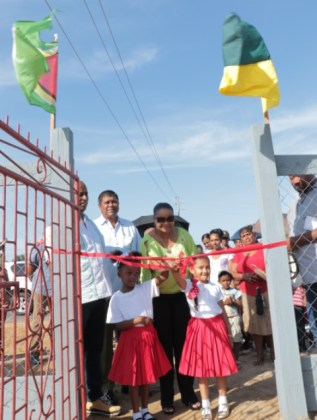 Minister of Social Protection Volda Lawrence, along with two young girls cutting the ribbon to open the recreational park in Rose Hall Town, Berbice