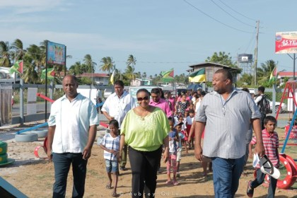 Mayor of Rose Hall Minster of Social Protection Volda Lawrence and Hilbert Foster (left to right) and other members of the community.
