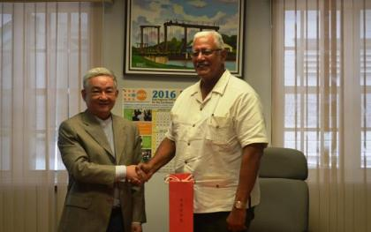 Agriculture Minister, Noel Holder and Chinese Ambassador H. E. Zhang Limin