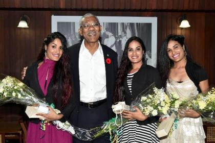 President David Granger is flanked by the birthday girls; from left to right: Ms. Radha Mansaram, Ms. Rajshri Mansaram and Ms. Reenica Mansaram.