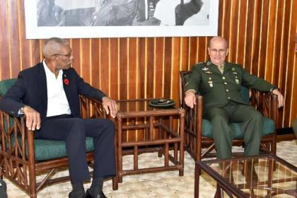 President David Granger engaging the Military Commander of the North of the Brazilian Armed Forces,  General Carlos Alberto Neiva Barcellos, during their meeting, this morning,  at the Ministry of the Presidency.