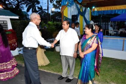 President David Granger is greeted and welcomed to the event by Prime Minister Moses Nagamootoo and Mrs. Sita Nagamootoo.