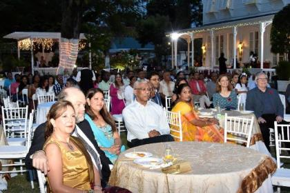 President David Granger, Ms. Angela Nagamootoo (left), daughter of Prime Minister Moses Nagamootoo and the United States Ambassador to Guyana, Mr. Perry Holloway and Mrs. Holloway enjoying the programme at the Prime Minister's residence.