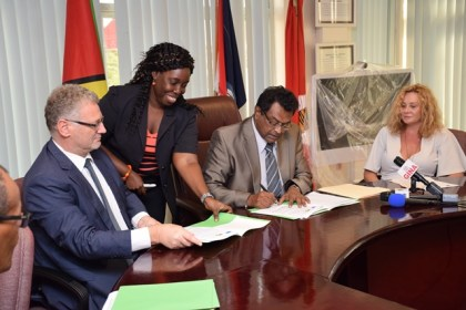 Minister of Public Security, Khemraj Ramjattan signing the MoU with Ambassador of the European Union, Jernej Videtic for the implementation of the Seaport Cooperation Programme (SEACOP) in Guyana