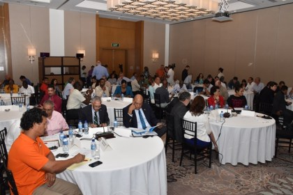 Minister of Natural Resources, Raphael Trotman and Minister of Business, Dominic Gaskin with others at the presentation of the final results of Guyana –Brazil market study for the land transport link and deep water port project