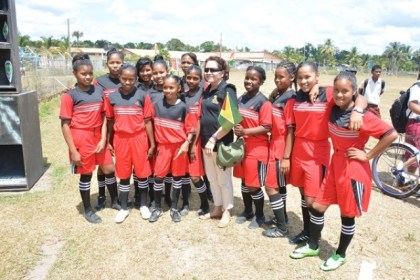 Students of the Kwakwani Football Club were excited to have their photograph taken with First Lady, Mrs. Sandra Granger.