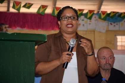 Chairperson of the Closed Areas Committee, Dela Britton addressing miners in Lethem