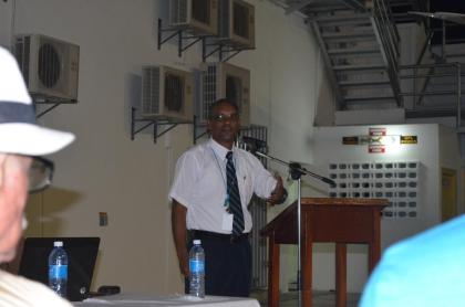Rickford Samaroo, Director of Air Navigation Services making his presentation at the consultation on Performance Based Navigation (PBN) and Automatic Dependent Surveillance-Broadcast (ADS-B) Implementation at the Eugene F. Correia International Airport