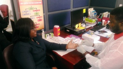 Minister within the Ministry of Public Health, Dr. Karen Cummings takes an HIV test