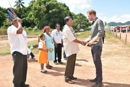 Prince Harry arrives at Surama Village and is greeted by Minister of Indigenous Peoples' Affairs,  Sydney Allicock.