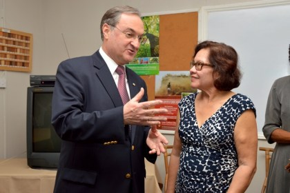 Dean of the Diplomatic Corps, Russia's Ambassador to Guyana, Mr. Nikolay Smirnov and First Lady, Mrs. Sandra Granger share a light moment after the presentation ceremony.
