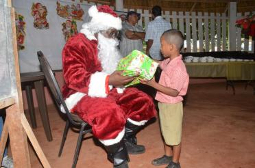 Santa also helps in the distribution of the gifts to the students at the Christmas Party in Campbelltown