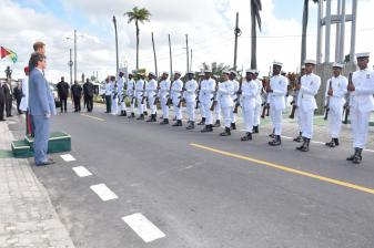 Prince Harry receives the military salute from members of the Guyana Defence Force under the Independent Arch at Brickdam
