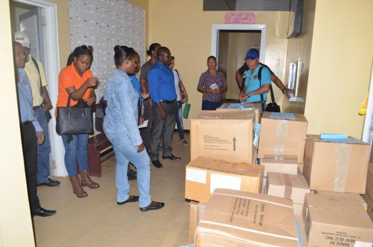 Minister of Public Health, Dr. George Norton and team, in Region One distributing and delivering drugs and medical supplies to health facilities within the region