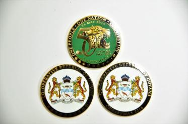 The commemorative coins distributed by President David Granger at the maternity ward of the GPHC today