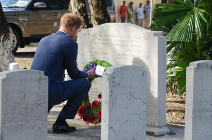 Prince Harry lays a wreath at the Commonwealth War memorial graves